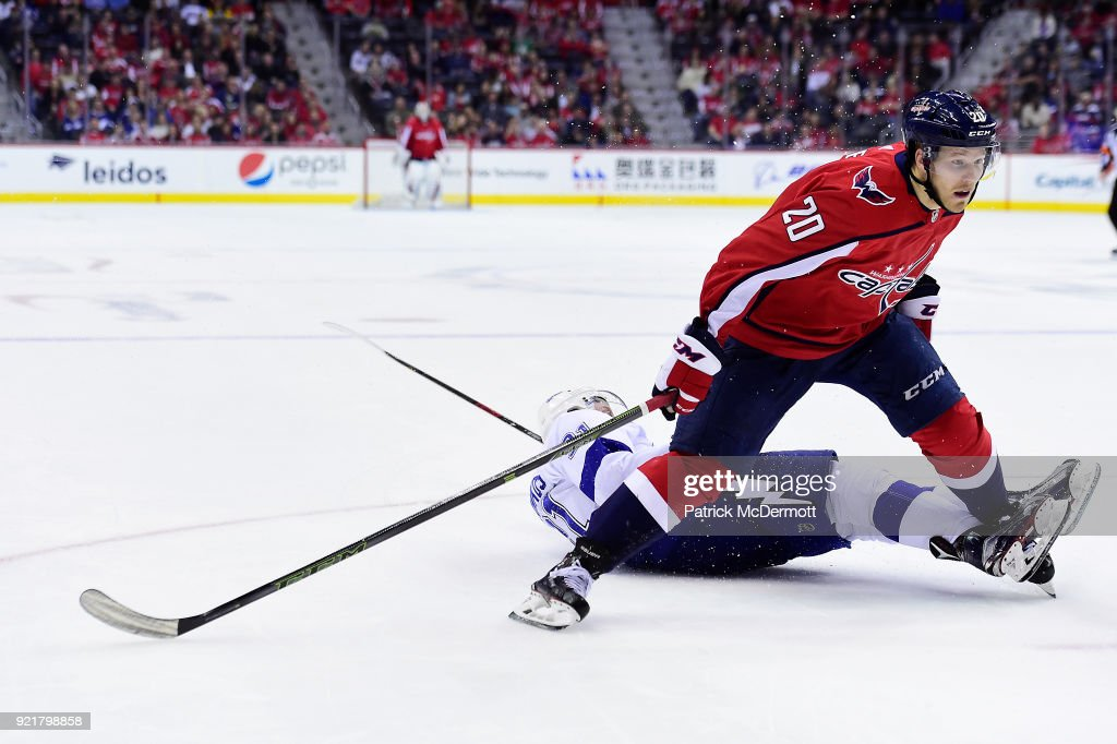 Lars Eller #20 of the Washington Capitals and Steven Stamkos #91 of the Tampa Bay Lightning battle for the puck in the third period at Capital One Arena on February 20, 2018 in Washington, DC.
