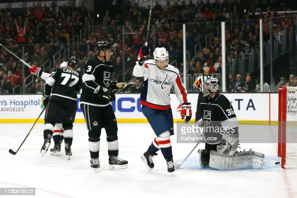 Lars Eller of the Washington Capitals celebrates a goal as Dion Phaneuf of the Los Angeles Kings and Jack Campbell of the Los Angeles Kings look on...