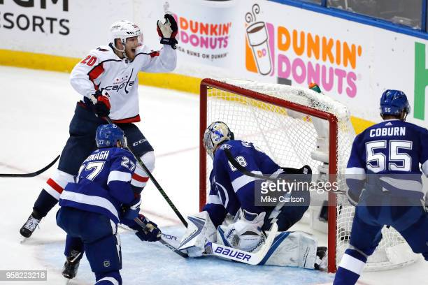 Lars Eller of the Washington Capitals celebrates teammate Evgeny Kuznetsov goal against Andrei Vasilevskiy of the Tampa Bay Lightning during the...