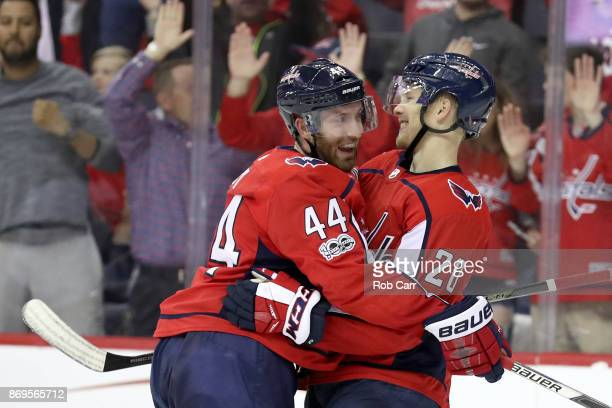Lars Eller of the Washington Capitals celebrates with Brooks Orpik after scoring a third period goal against the New York Islanders at Capital One...