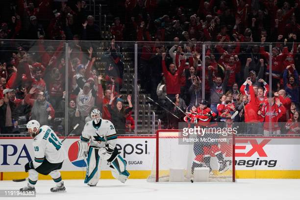 Lars Eller of the Washington Capitals celebrates with John Carlson after scoring the game winning goal in overtime against the San Jose Sharks at...