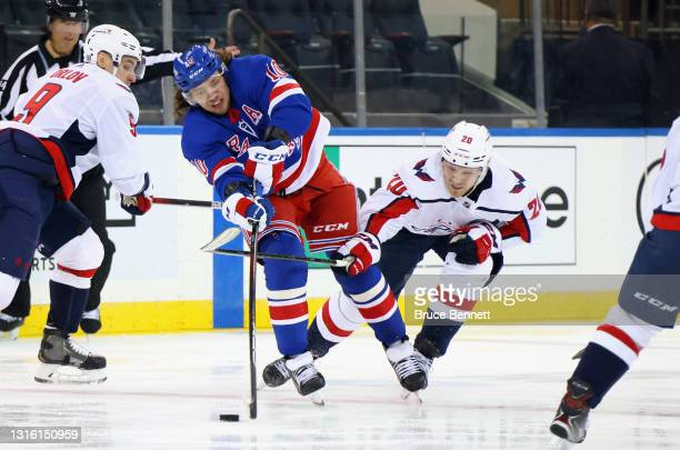 Lars Eller of the Washington Capitals checks Artemi Panarin of the New York Rangers during the second period at Madison Square Garden on May 03, 2021...