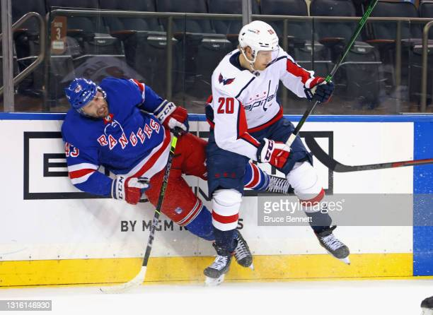 Lars Eller of the Washington Capitals checks Colin Blackwell of the New York Rangers during the first period at Madison Square Garden on May 03, 2021...