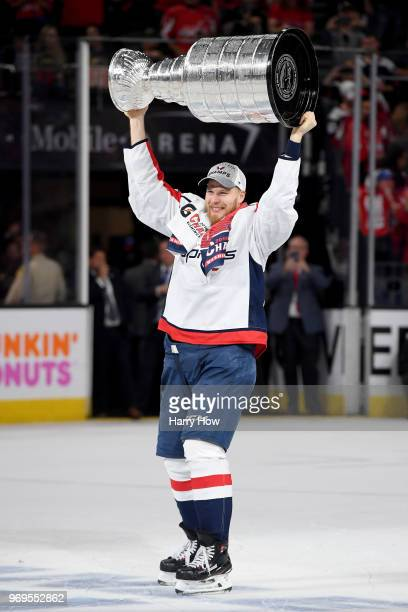 Lars Eller of the Washington Capitals hoists the Stanley Cup after his team's 43 win over the Vegas Golden Knights in Game Five of the 2018 NHL...