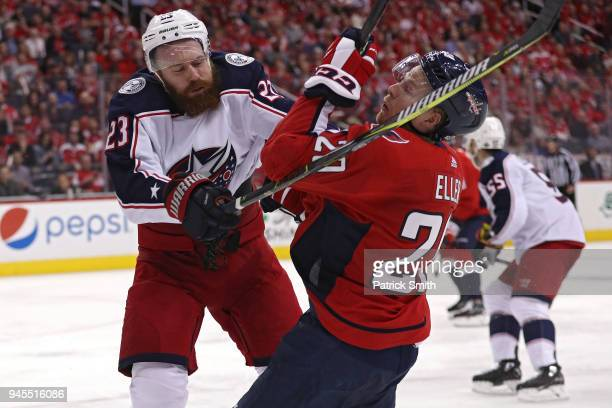 Lars Eller of the Washington Capitals is checked by Ian Cole of the Columbus Blue Jackets in the second period in Game One of the Eastern Conference...