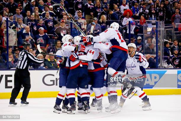 Lars Eller of the Washington Capitals is congratulated by his teammates after scoring the game winning goal against the Columbus Blue Jackets in...