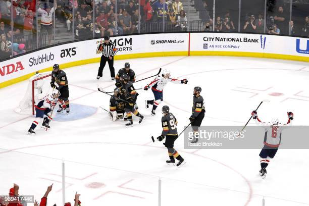 Lars Eller of the Washington Capitals is congratulated by his teammates after scoring a thirdperiod goal past MarcAndre Fleury of the Vegas Golden...