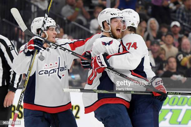 Lars Eller of the Washington Capitals is congratulated by his teammates Andre Burakovsky and John Carlson after scoring a first-period goal against...