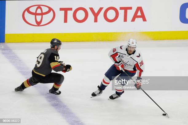 Lars Eller of the Washington Capitals is defended by Reilly Smith of the Vegas Golden Knights during the first period in Game Five of the 2018 NHL...