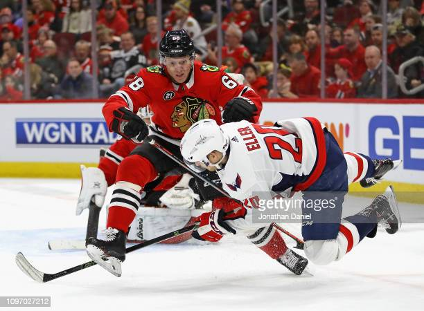 Lars Eller of the Washington Capitals is dumped by Slater Koekkoek of the Chicago Blackhawks at the United Center on January 20 2019 in Chicago...