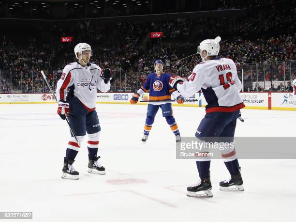 Lars Eller of the Washington Capitals is greeted by Jakub Vrana following his1p goal against the New York Islanders at the Barclays Center on March...