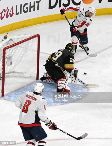 Lars Eller of the Washington Capitals passes the puck past Marc-Andre Fleury of the Vegas Golden Knights to Alex Ovechkin for a goal in the second...