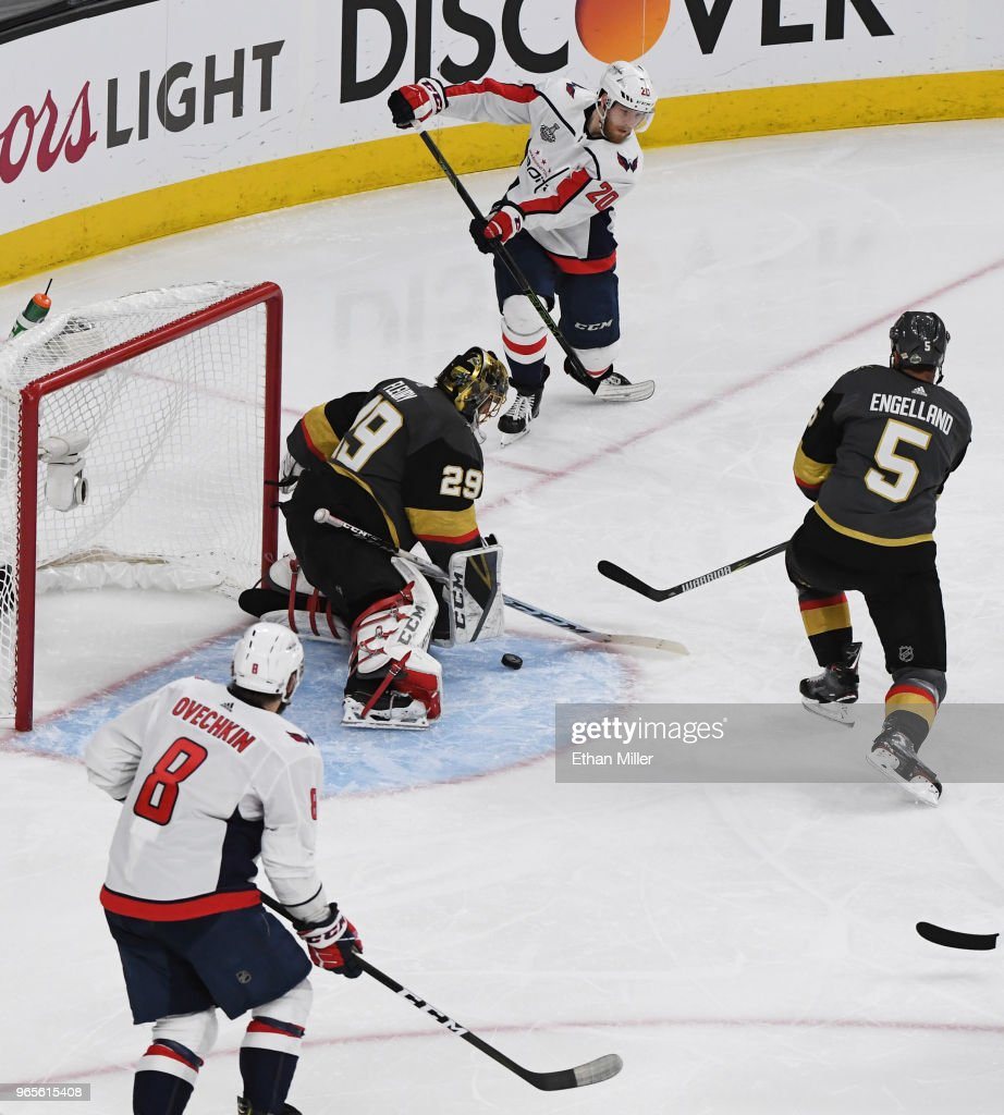 Lars Eller #20 of the Washington Capitals passes the puck past Marc-Andre Fleury #29 and Deryk Engelland #5 of the Vegas Golden Knights to Alex Ovechkin #8 for a goal in the second period of Game Two of the 2018 NHL Stanley Cup Final at T-Mobile Arena on May 30, 2018 in Las Vegas, Nevada. The Capitals defeated the Golden Knights 3-2.