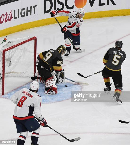 Lars Eller of the Washington Capitals passes the puck past Marc-Andre Fleury and Deryk Engelland of the Vegas Golden Knights to Alex Ovechkin for a...