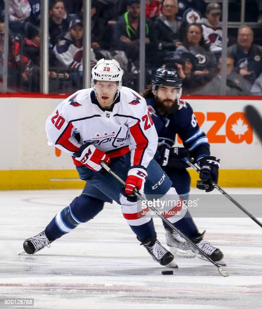 Lars Eller of the Washington Capitals plays the puck up the ice during third period action against the Winnipeg Jets at the Bell MTS Place on...