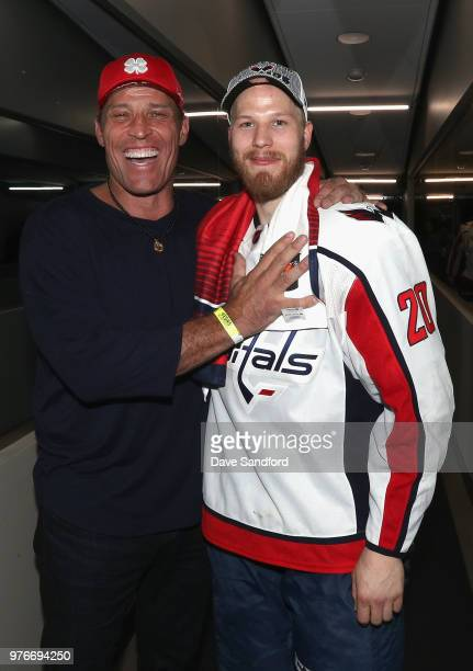 Lars Eller of the Washington Capitals pose with life coach Tony Robbins after the Capitals won the Stanley Cup by defeating the Vegas Golden Knights...