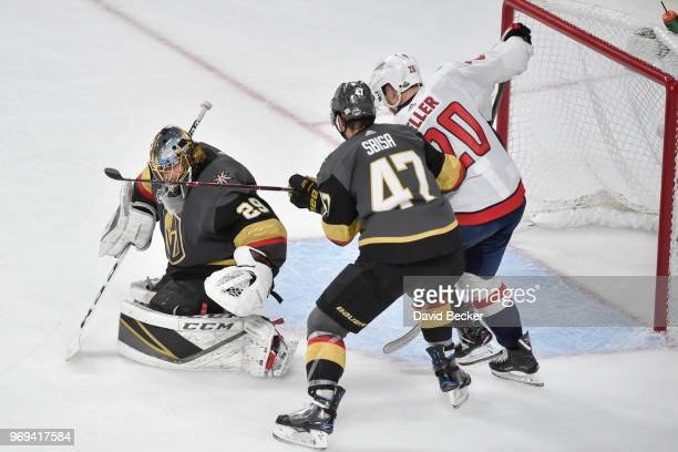 Lars Eller of the Washington Capitals scores a goal with Luca Sbisa and MarcAndre Fleury of the Vegas Golden Knights defending in Game Five of the...
