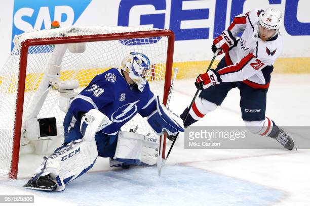 Lars Eller of the Washington Capitals shoots the puck against Louis Domingue of the Tampa Bay Lightning during the third period in Game One of the...