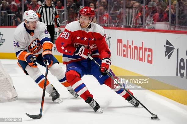 Lars Eller of the Washington Capitals skates with the puck against Scott Mayfield of the New York Islanders in the first period at Capital One Arena...