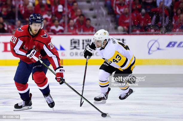 Lars Eller of the Washington Capitals skates with the puck against Conor Sheary of the Pittsburgh Penguins in the first period in Game One of the...