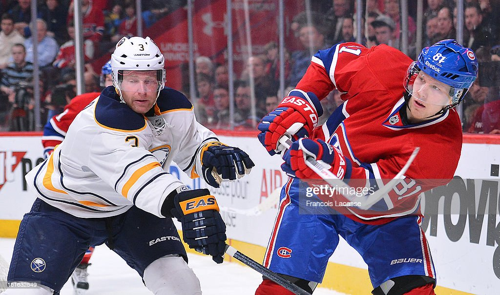 Lars Eller #81of the Montreal Canadiens makes a pass against Jordan Leopold #3 of the Buffalo Sabres during the NHL game on February 2, 2013 at the Bell Centre in Montreal, Quebec, Canada.