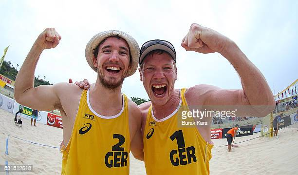 Lars Fluggen and Markus Bpckermann of Germany pose as they celebrate their win against Greece in the men's semi final match of the FIVB Antalya Open...