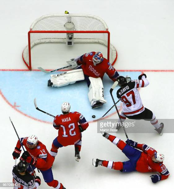 Lars Haugen goaltender of Norway tends net against Connor McDavid of Canada during the 2018 IIHF Ice Hockey World Championship Group B game between...