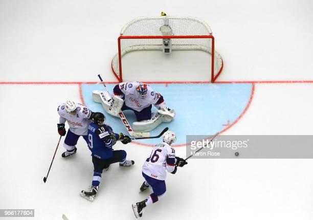 Lars Haugen, goaltender of Norway tends net against Veli Matti Savinainen of Finland during the 2018 IIHF Ice Hockey World Championship group stage...