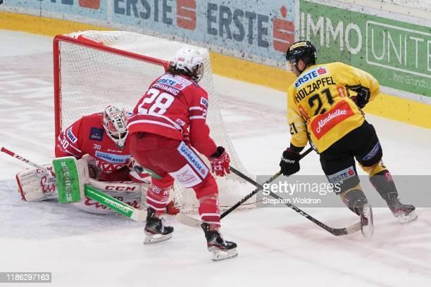 Lars Haugen of Klagenfurt Martin Schumnig of Klagenfurt and Riley Holzapfel of Vienna during the Vienna Capitals v EC KAC Erste Bank Eishockey Liga...