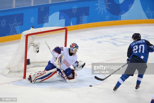 Lars Haugen of Norway and Eeli Tolvanen of Finland during the Men's Ice Hockey Preliminary game between Finland and Norway at Gangneung Hockey Centre...