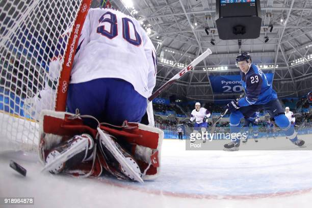 Lars Haugen of Norway gives up a goal to Eeli Tolvanen of Finland in the first period during the Men's Ice Hockey Preliminary Round Group C game at...