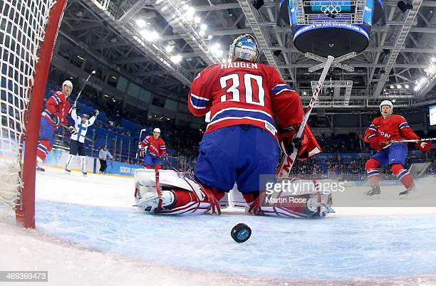 Lars Haugen of Norway gives up a goal to Teemu Selanne of Finland in the first period during the Men's Ice Hockey Preliminary Round Group B game on...