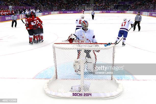 Lars Haugen of Norway looks on as Jamie Benn of Canada celebrates with his teammates after scoring a goal in the second period against Norway during...