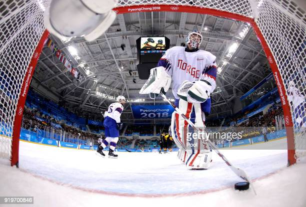 Lars Haugen of Norway reacts after allowing a goal against Patrick Hager of Germany in the second period during the Men's Ice Hockey Preliminary...