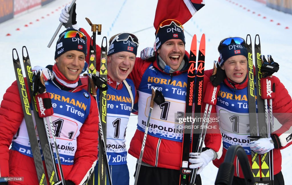 Lars Helge Birkeland, Johannes Thingnes Boe, Emil Hegle Svendsen and Tarjei Boe of Norway celebrate winning the men's 4 x 7,5km relay event at the Biathlon World Cup on January 12, 2018 in Ruhpolding, southern Germany. Norway won the evend ahead of France (2nd) and Russia (3rd). /