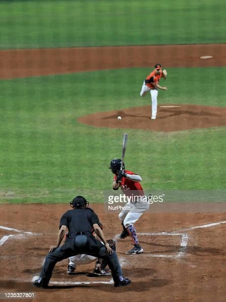 Lars Huijer throw the ball and Kent Blackston hits the ball during the Baseball match Baseball European Championship 2021 - Quarter finals -...
