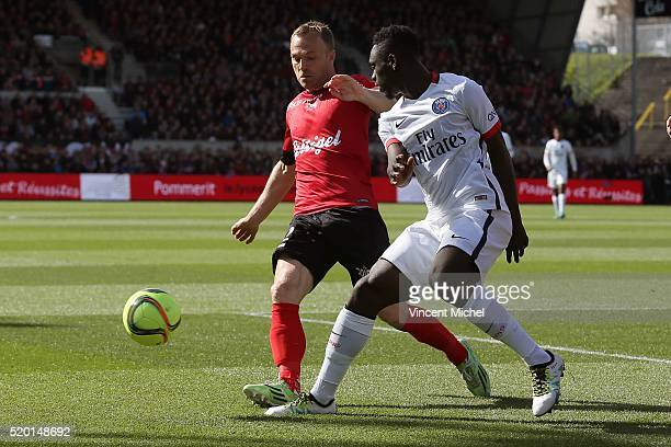 Lars Jacobsen of Guingamp and Jean Kevin Augustin of Paris SaintGermain during the French League 1 match between EA Guingamp and Paris SaintGermain...