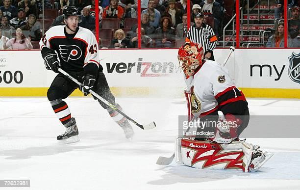 Lars Johnson of the Philadelphia Flyers takes a shot on goal against Ray Emery of the Ottawa Senators on November 22 2006 at the Wachovia Center in...
