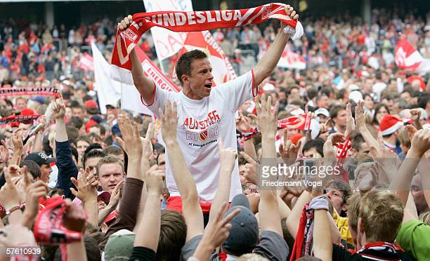 Lars Jungnickel of Cottbus celebrates after the winning Second Bundesliga match between Energie Cottbus and 1860 Munich at the Stadion der...