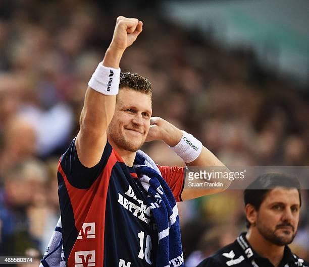 Lars Kaufmann of Flensburg celebrates during the Bundesliga handball game between SG FlensburgHandewitt and SG BBM Bietigheim at the Flens Arenaon...