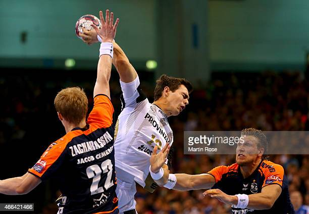 Lars Kaufmann of Flensburg challenges Rasmus Lauge of Kiel for the ball during the VELUX EHF Champions League Round of 16 first leg match between SG...