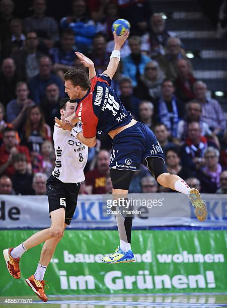 Lars Kaufmann of Flensburg is challenged by Timo Salzer of Bietgheim during the Bundesliga handball game between SG FlensburgHandewitt and SG BBM...