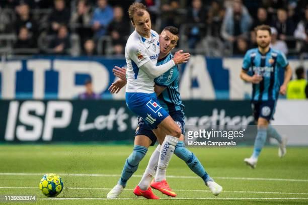Lars Krogh Gerson of IFK Norrkoping collides with Djurgardens Haris Radetinac during the Allsvenskan match between Djurgardens IF and IFK Norrkoping...