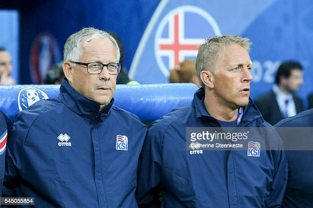 Lars Lagerback and Heimir Hallgrimsson Head Coaches of Iceland are singing the national anthem prior to the UEFA EURO 2016 Quarter Final match...