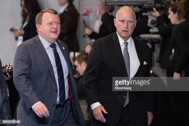 Lars Lokke Rasmussen Denmark's prime minister left and Jerry Brown governor of California arrive at the One Planet Summit in Paris France on Tuesday...