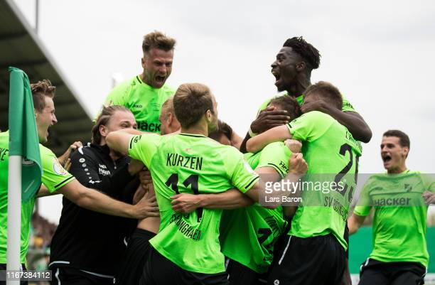 Lars Lokotsch of Roedinghausen celebrates with team mates after scoring his teams third goal during the DFB Cup first round match between SV...