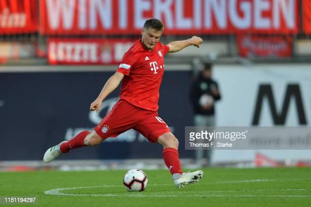 Lars Lukas Mai of Muenchen kicks the ball during the Third League Playoff First Leg match between VfL Wolfsburg II v Bayern Muenchen II at AOKStadion...