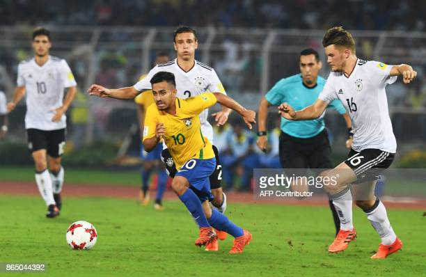 Lars Mai of Germany and Alan of Brazil compete for the ball during the quarterfinal football match of the FIFA U17 World Cup at the Vivekananda Yuba...