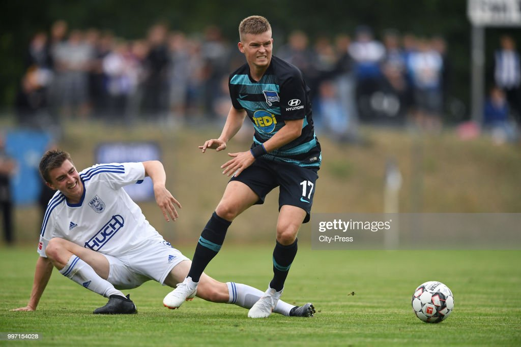 Lars Mueller of MSV Neuruppin and Maximilian Mittelstaedt of Hertha BSC during the game between MSV Neuruppin against Hertha BSC at the Volkspar-Stadion on july 12, 2018 in Neuruppin, Germany.