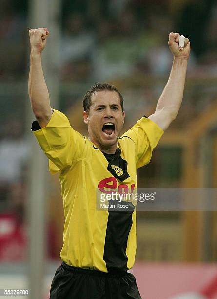 Lars Ricken of Dortmund celebrates scoring the first goal during the Bundesliga match between Borussia Dortmund and 1 FC Cologne at the...
